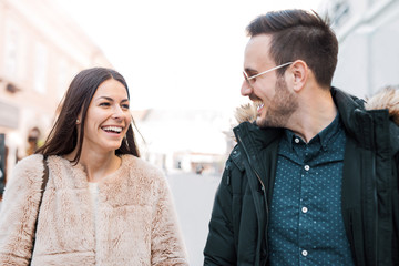 Beautiful smiling couple on date walking down the street. Love a
