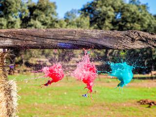 Balloons exploding when hit by an arrow. Closeup hi-speed shot