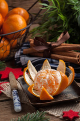 Peeled tangerine on the wooden table.