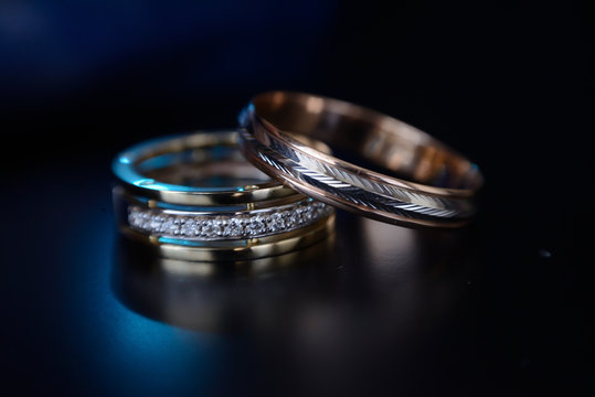Beautiful wedding golden rings on dark background