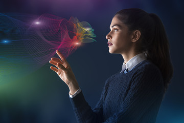 concept of a young woman selecting colors on projected rainbow color spectrum vector lines of cloud shape