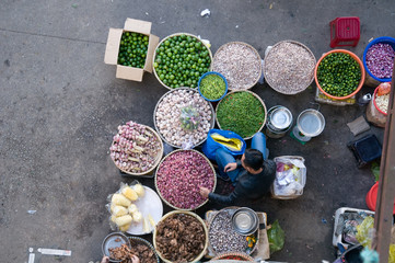 People sell and buy vegetables at farmers market in Dalat, Vietnam