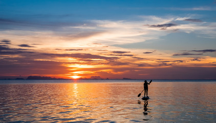 Girl on the paddleboard on the tropical island