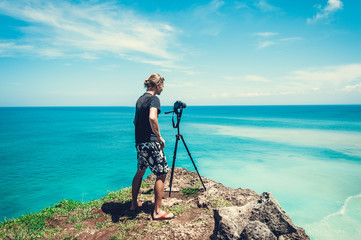 Photographer making photo of amazing view at the ocean