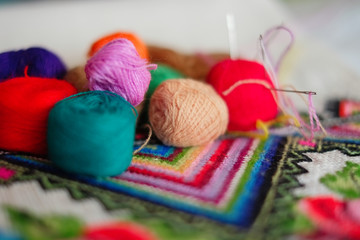 colored thread for cross-stitching with a needle