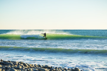 Surfing in the winter, and ocean wave