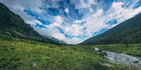 Fabulous clouds in the middle of the green hills, Altai, Russia