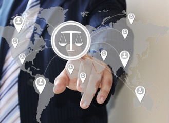 The businessman clicks on the icon of security shield with the sign Libra. The man touched the buttons Balan.  The concept of security of justice .Business, Security, Internet, court, Tribunal.