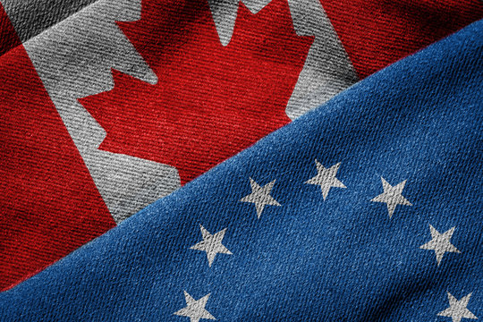 CETA Concept: Flags of EU and Canada on Grunge Texture