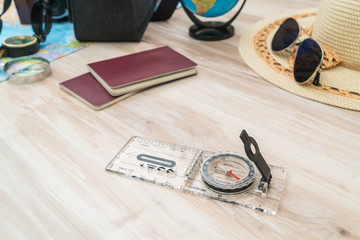 Travel preparation : compass, money, passport, road map ,hat,sun
