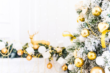 Christmas tree background, bright gold ornaments new year, white fireplace