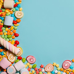 Colorful marshmallow candies and jellies as background