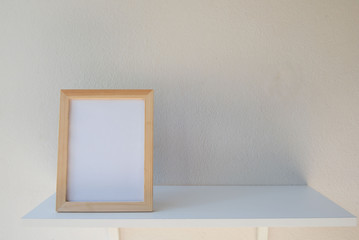 photo Frame on a wooden on White background .