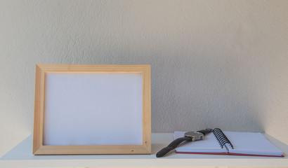 photo Frame on a wooden and book on White background .