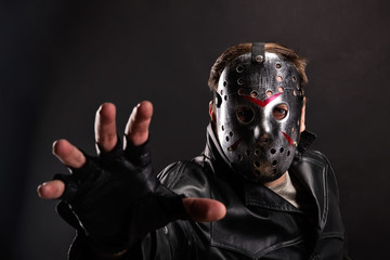 Maniac in hockey mask on dark background