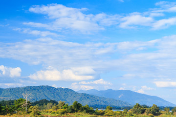Blue sky with clouds mountain forest  nature landscape