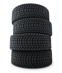 Stack of automobile winter tires isolated on white background.