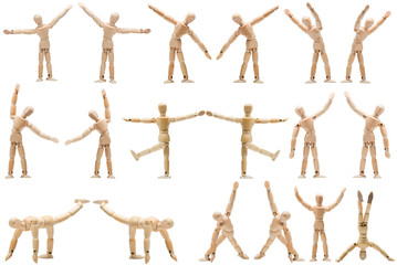 A large group of wooden mannequins in various poses yoga isolate