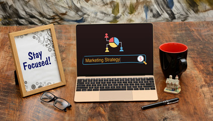 Marketing Strategy on Laptop Screen with Office Environment