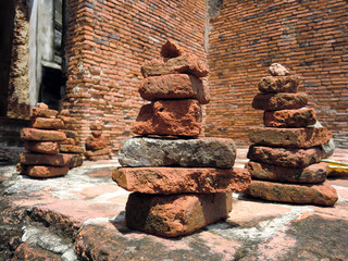 Rock stack cairns placed near ancient Thai Buddhist temple