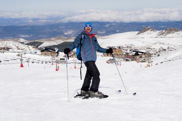 happy man happy in snow mountains at Sierra Nevada ski resort in Spain