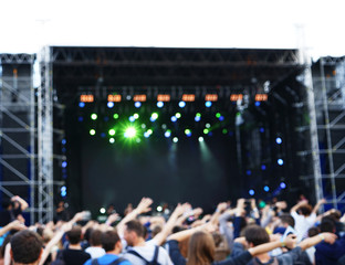 Blurred background of crowd at open air concert