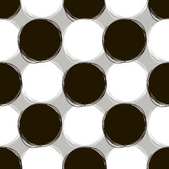 Seamless doodle pattern. Round doodle patterns of white and black color on a gray background