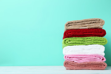 Colorful towels on green background