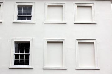 Georgian windows architecture on a wall house, London, UK