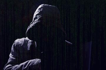 hacker silhouette with matrix code
