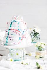 Amazing Wedding cake with decoration on white wooden table