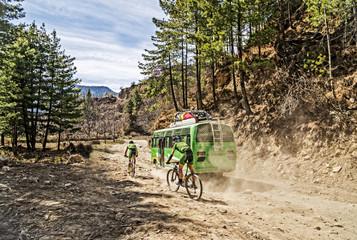 Mountain biking in Nepal. Two men riding bikes. Mountain biking on Annapurna high mountain region.
