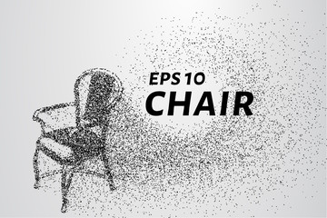 Chair made of particles. The chair crumbles into small circles and dots.