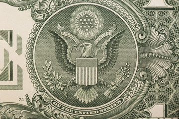 A one dollar bill close up, showing the eagle on the great seal of the United States