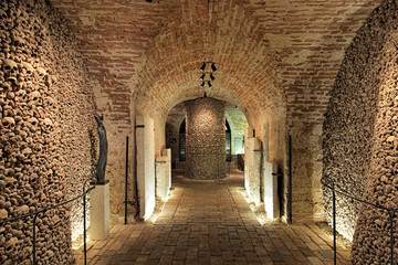 Interior of the underground ossuary under the Church of St. James in Brno, Czech Republic. The ossuary holds the remains of over 50 thousand people which makes it the second-largest ossuary in Europe.