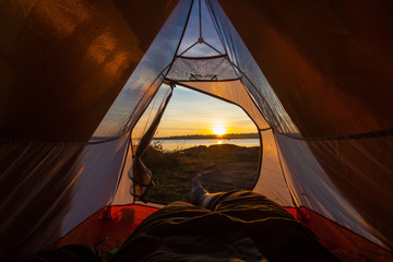 camping tent glow up with sunrise in morning