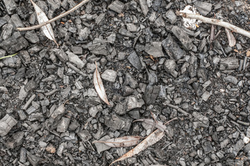 Black ashes or charcoal texture, background