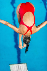 Wall Mural - Female diver jumping