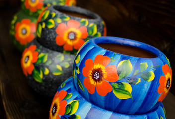 Stack of Mexican ceramic pots, blue and grey background