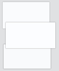 Three white sheet blank on a gray background.