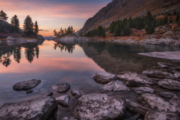 Mirror Lake Surface Reflecting Sunset Light And Pine Trees, Altai Mountains Highland Nature Autumn Landscape Photo