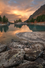Vertical View Of Sunset Lake With A Rocky Shore, Altai Mountains Highland Nature Autumn Landscape Photo