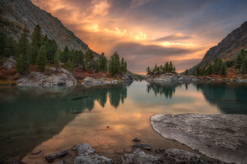 Rocks And Trees Reflecting In Pink Waters Of Sunset Mountain Lake, Altai Mountains Highland Nature Autumn Landscape Photo