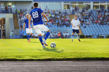 Football match in sunny summer day