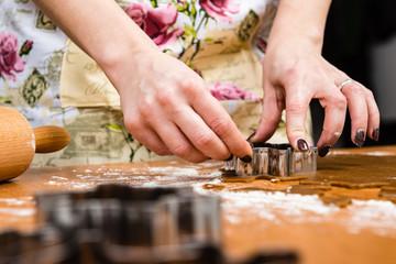 Making Gingerbread Cookies Series. Cutting dough sheet into shap