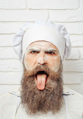 Cook or baker shows tongue
