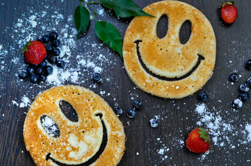 pancakes in the shape of a smiley