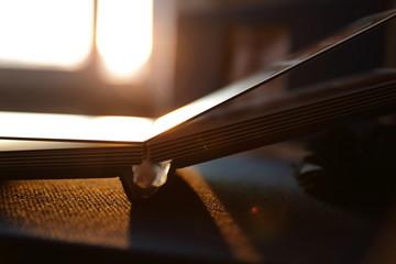 Photobook binding at sunset