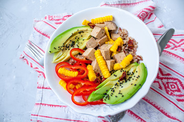 Brown rice with avocado, peppers and tofu. Vegan healthy lunch or dinner. Love for a healthy raw food concept.