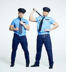 two policemen, striptease